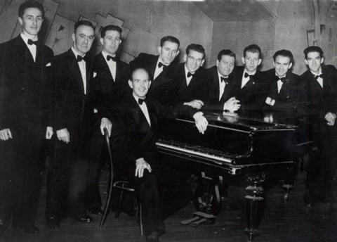 (LtoR) Mick McWilliams, Leo O'Donnell, Phil Hegarty, Tony Black, Michael Cutliffe,John Cowley, Leonard Callan, Don MacCafferty, John McCabe, James MacCafferty (at the piano)